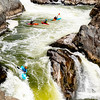 Group of Kayakers watch their buddy go over the Great Falls on the Potomac River