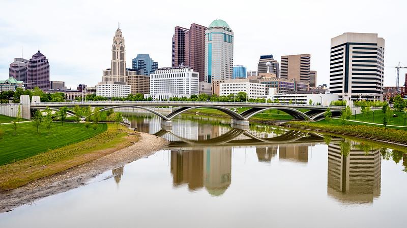Columbus Ohio skyline and reflection with bridge