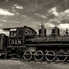 Antique train with cloudy sky Black and White
