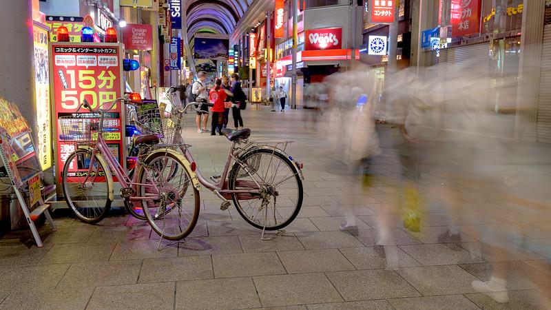 School girls walking by bikes Hiroshima Hondori