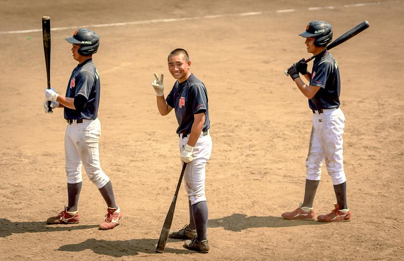 Little League baseball players on deck in Japan