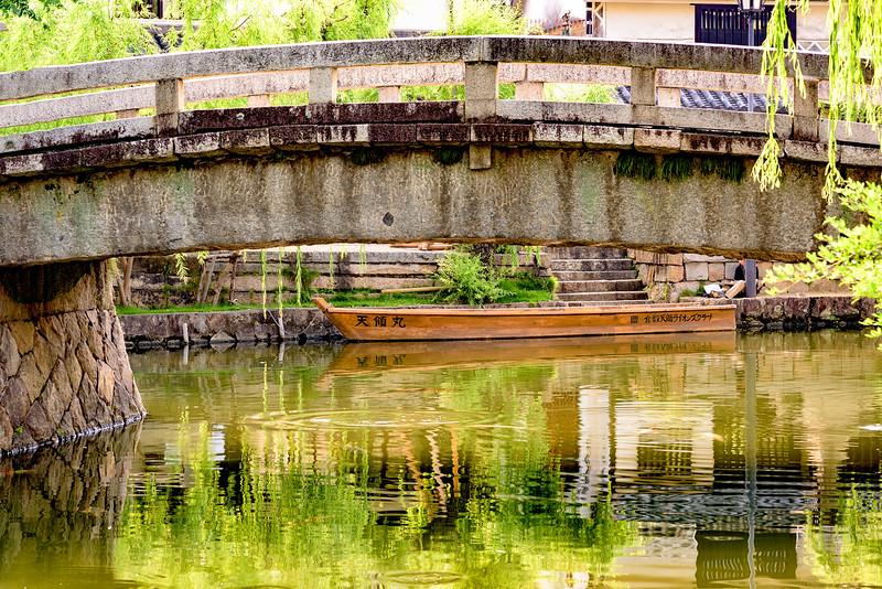 Kurashiki water way with bridge and boat