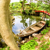 Red bridge and boat at SHUKKEIEN garden