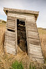 Rickety old outhouse made of wood and on a farm in Idaho