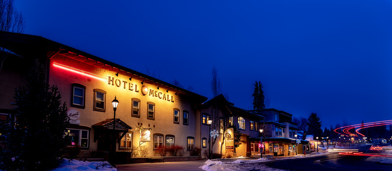 Famous McCall hotel at night with streaking car lights