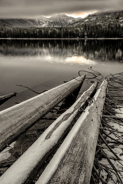 Logs lead into Upper Payette Lake sunrise