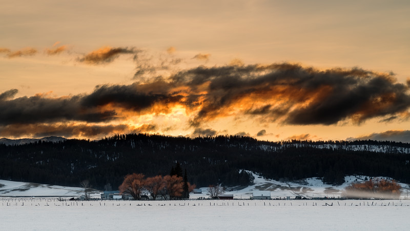 Dramatic winter sunrise over an Idaho farm