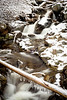 Winter stream with ice and snow