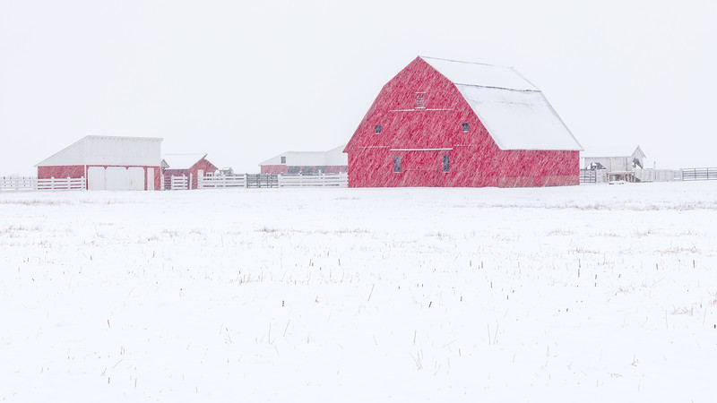 Red Barn and snow in winter near Meadows Idaho