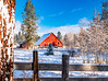 Red Barn in the winter with fence and snow