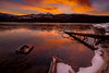 Burning orange sky over Upper Payette Lake near McCall Idaho