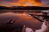 Burning orange sky over Upper Payette Lake near McCall Idaho