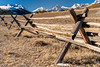 Old wood fence with a snow covered mountains behind