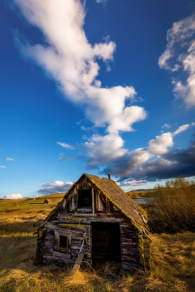 Building clouds over a Log sauna on the rolling hills near McCall