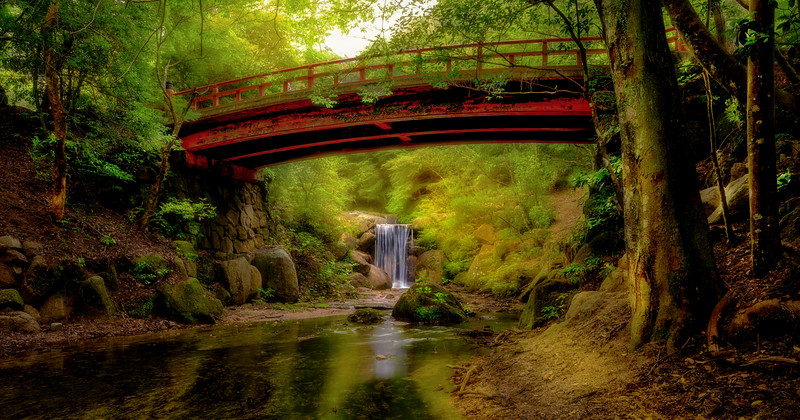 Waterfall and bridge in Japan forest