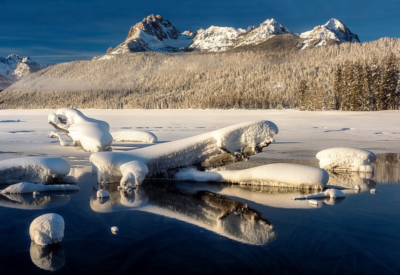 Snow covered log reflections Redfish Lake