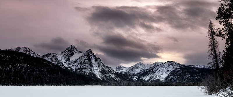 Colors of evening paint the sky over Stanley Lake winter