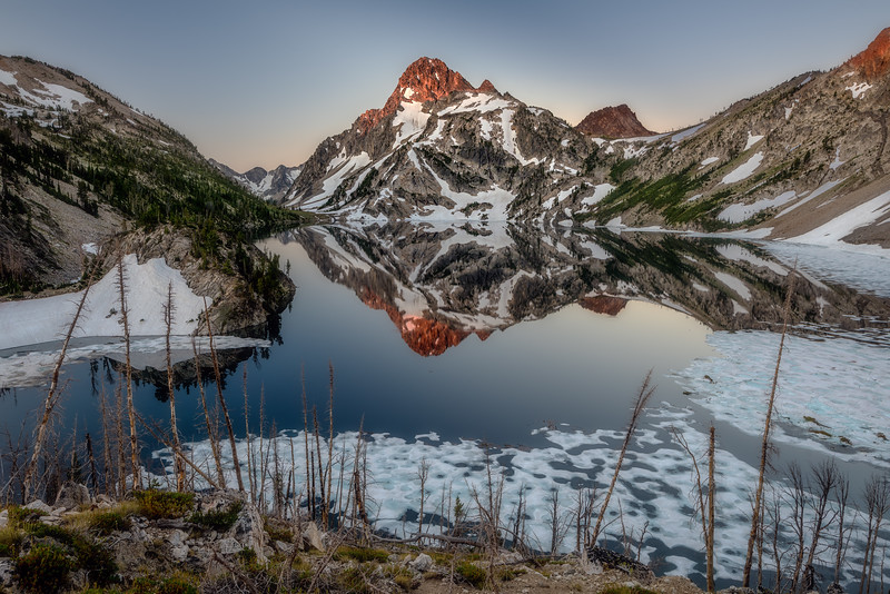 First light on Mt. Regan and Sawtooth Lake reflection