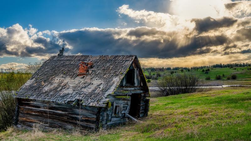 Finnish Sauna log building with red brick chimney