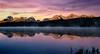Still water sunrise reflection Little Redfish Lake