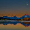 Oxbow Tetons sunrose over mout Moran with full moon
