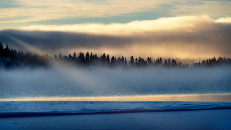 Clearing fog over Payette Lake winter morning