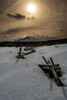 Log fence with afternoon sun winter Sawtooths
