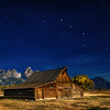 Mormon Row Barn night illuminated by full moon with big dipper