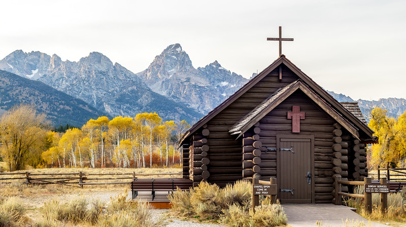 small country church and magnificent Tetons mountain range backdrop in fall