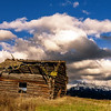 Dramatic evening sky with Finnish Log building and Jug Mountain