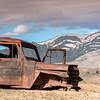 Antique rusted puckup truck and Idaho mountains