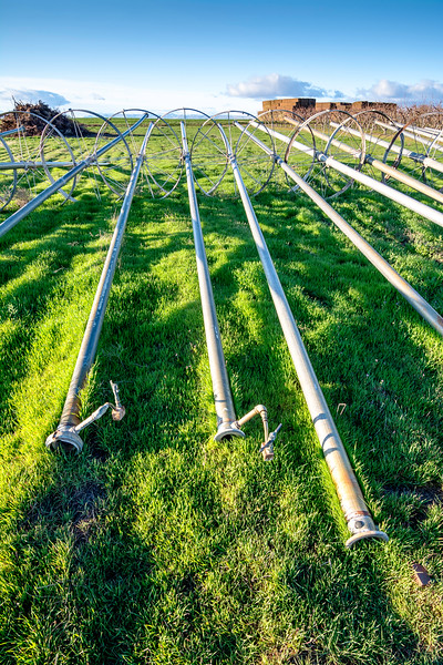 Unique view of irrigation pipe on farm in the morning