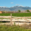 Custom wood fence and snow covered Idaho mountains