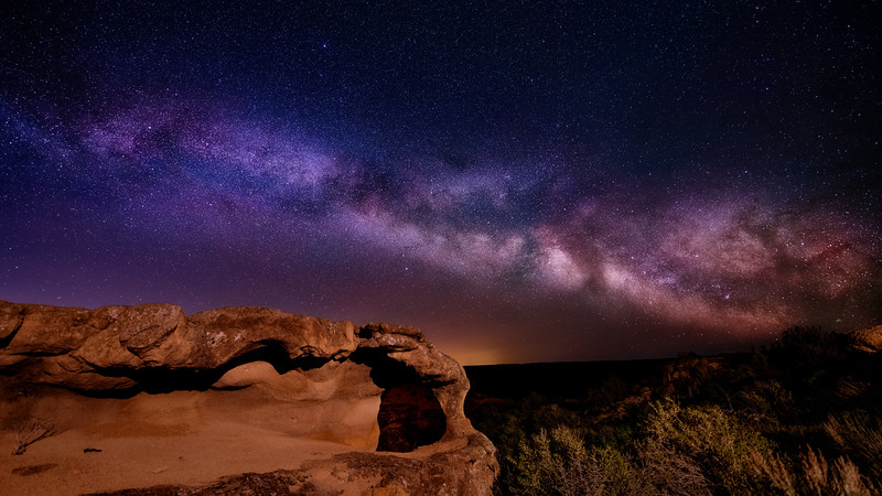 Arch in Oolite rock at night with Milky Way