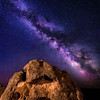 Close up of an Oolite bolder at night with the Milky Way coming out of it