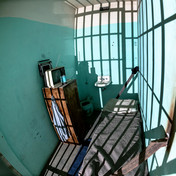 Single death row jail cell with TV and bed