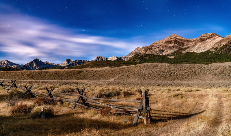 Lost River Range with pole fence by moonlight