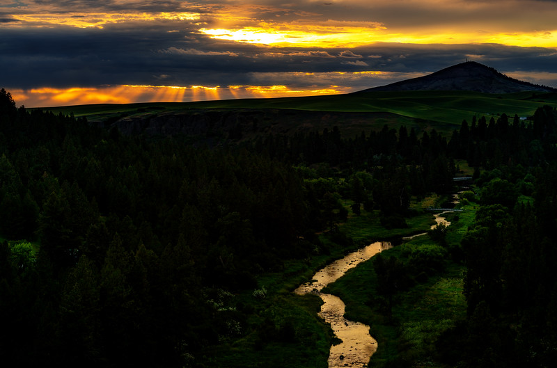 Dramatic sunset over Steptoe Butte with Palouse River reflection