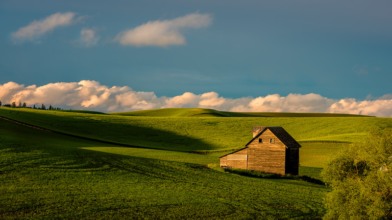 Late evening sun on Palouse barn with clouds