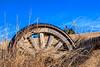 Farm impliment wheel left in teh grass