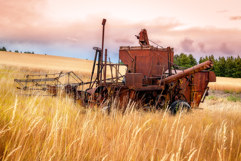 Rusted old combine abandoned in the fields of the Palouse of Idaho
