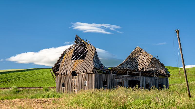 Collapsing barn in a farmer's field