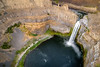 View from above of Palouse Falls with river feeding the falls