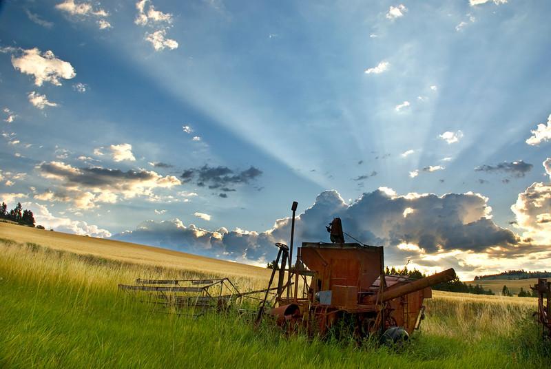 Palouse Farm combine and sunrays