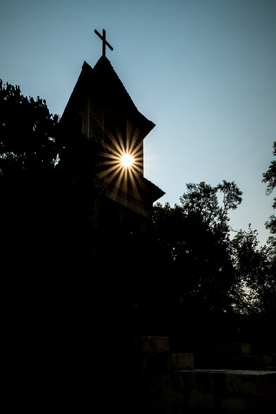 Saint Josephs Mission in Idaho with sun star peaking through bell tower