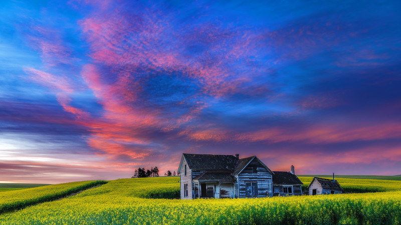 Rural schoolhouse with dramatic sunrise
