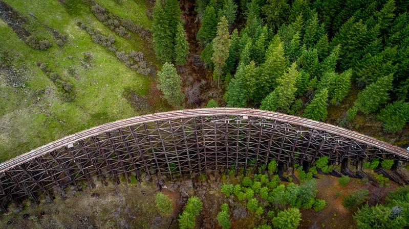 Rustic old train bridege leads through Idaho wilderness