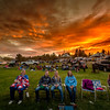 Spectaters in chairs at sunset wait for Placerville firewors show