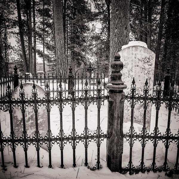 Steel rod fence in a mountain cemetery