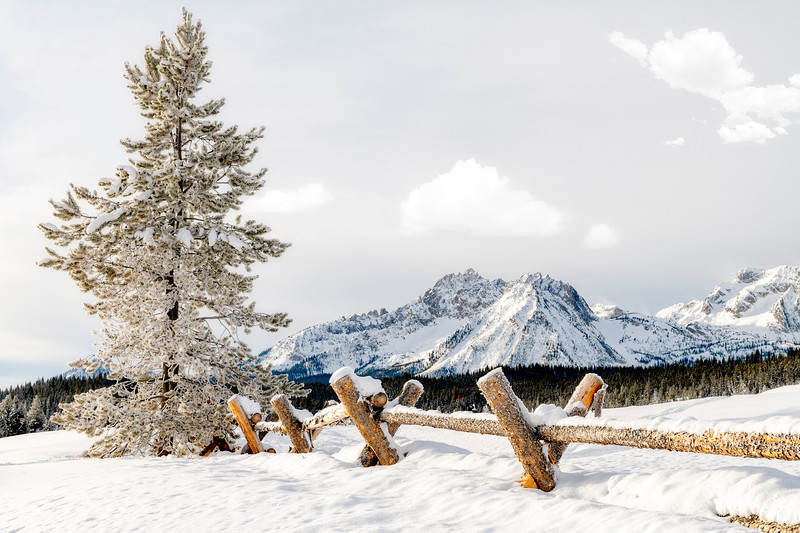 Sawtooth mountains of Idaho in winter with fence foreground